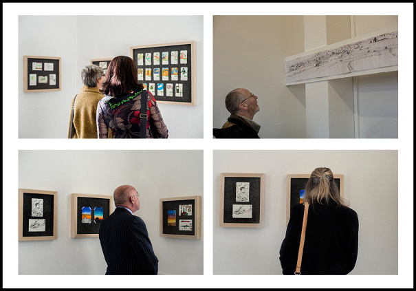 Visitors to the Combart Art exhibition look at some of the artworks created in Afghanistan by Royal Marines.