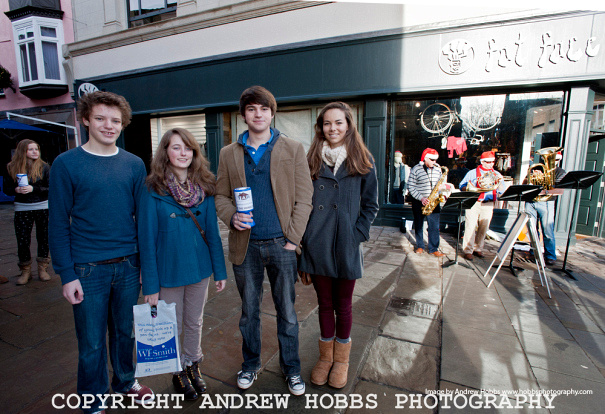 Students form Queens College college collect money.
