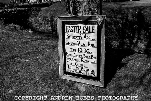 A sign on the Winsford village green advertising a village sale